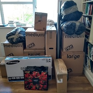 Delivery I6 boxes and bags and a bike.
