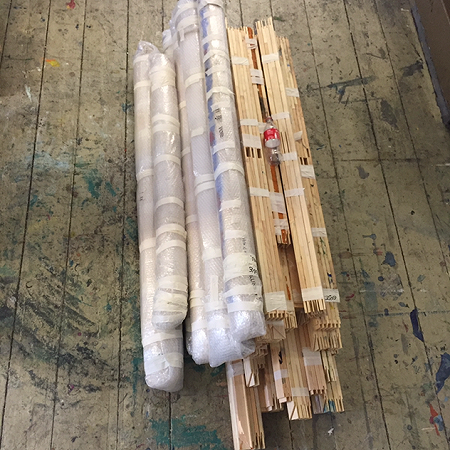 Rolls of paintings and wood strechers