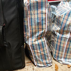 Delivery 3 carrier  bags and suitcase